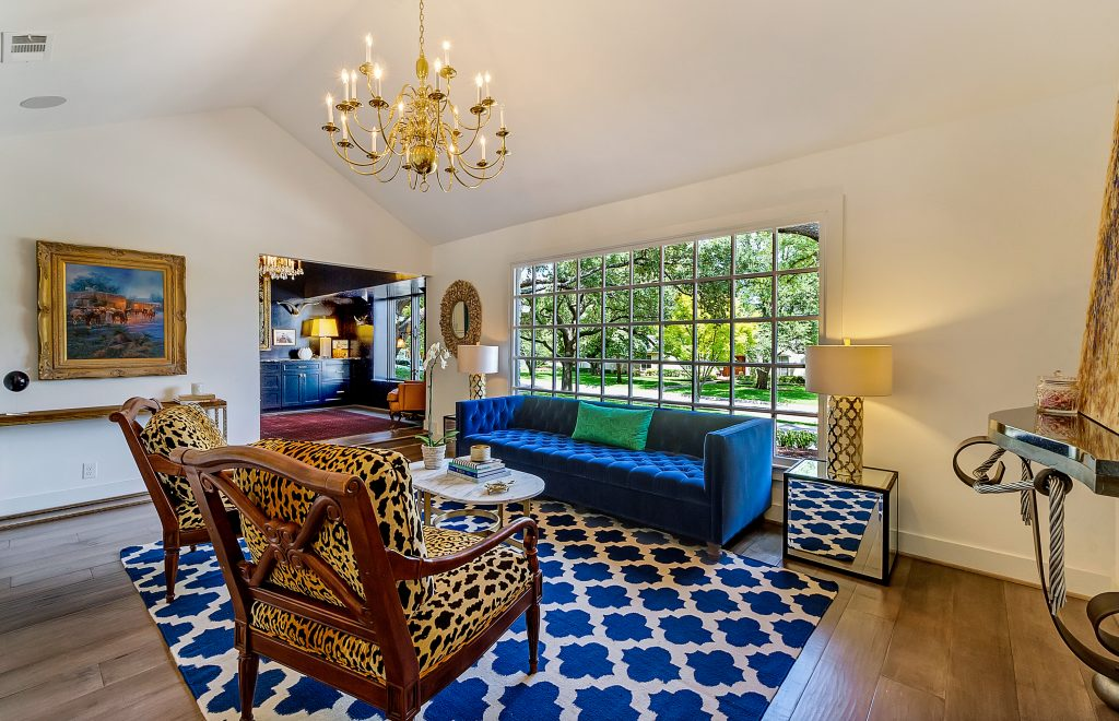 Rich jewel tones, various patterns through out, large window, spacious, white walls for colors accents from furniture and decor