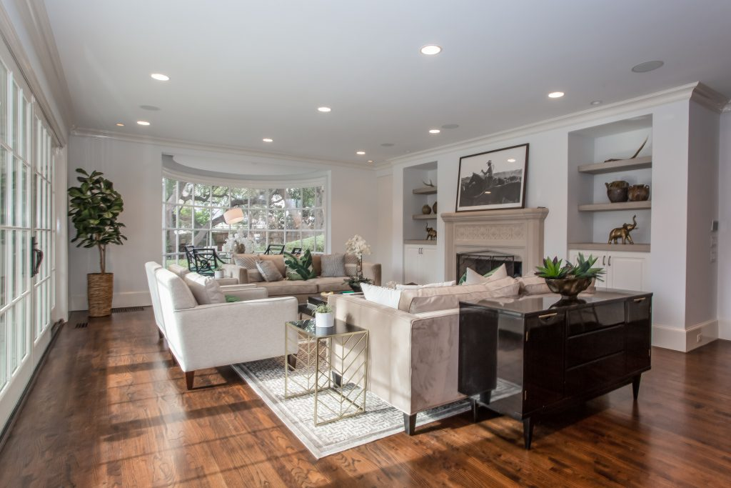Simple style, medium brown hardwood floors, large window for natural lighting, simple furniture, muted tones